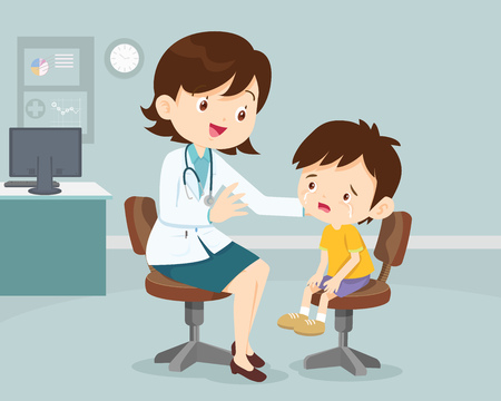Female Doctor Comforting Her Patient boy. Healthcare for children. Pediatrician in the Clinic