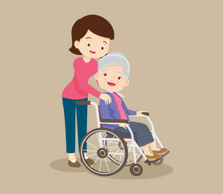elderly woman sit in a wheelchair and the daughter tenderly puts hands on her shoulders.Daughter cares for mother.Careful caregiver taking care of the patient