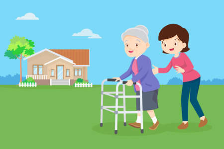 Young woman taking care of an elderly woman. Woman Caring for Grandmother. daughter helps her mother walking with walker in the front yard.