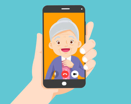 Hand holding smartphone with elderly on screen.Video call with grandparents or aging parents.
