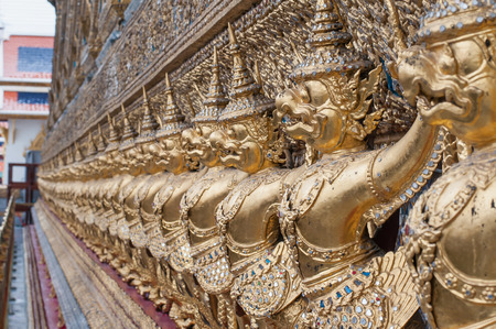 wat: Wat Phra Kaeo, Temple of the Emerald Buddha and the home of the Thai King. Wat Phra Kaeo is one of Bangkoks most famous tourist sites and it was built in 1782 at Bangkok, Thailand. Stock Photo