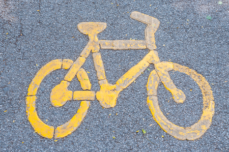 yellow bicycle lane sign on road, pathway for bicycle Stock Photo