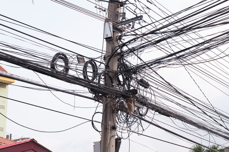 disarrangement: Disarrangement Concept, Tangled Electrical Wire on Electricity Post