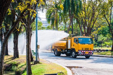 Water truck watering in the garden Stock Photo