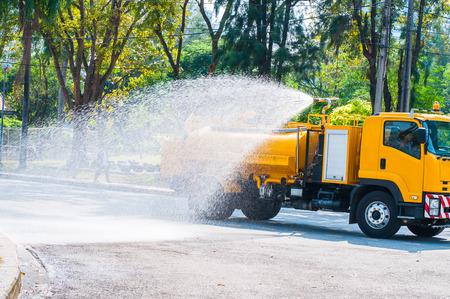 contracting: Water truck watering in the garden