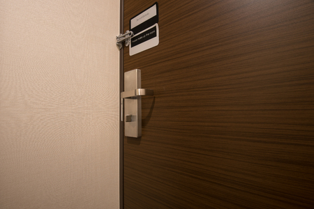 door handle: Modern, door handle and locked wooden door Stock Photo