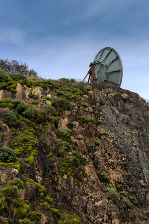 remote communication: Satellite located on the hilltop. Covered with lush green plants. A satellite dish receiver Sent remote optimization of communication. Stock Photo