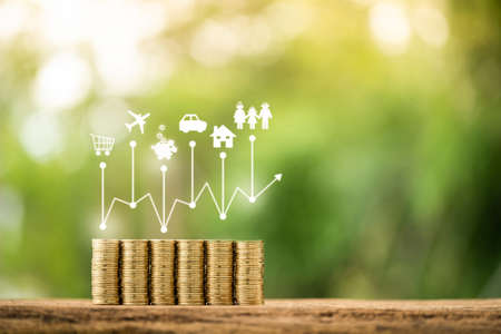 Stacked gold coin and growth chart on transparent screen of shopping cart and plane and piggy bank and car and home and family is linked system, Business planning investment in the future concept.