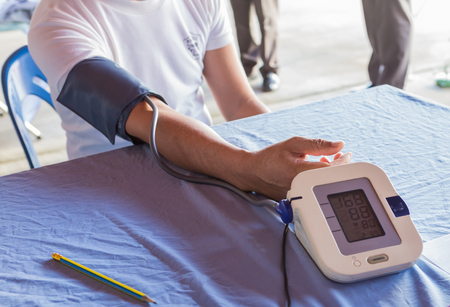 blood pressure monitor: Man have blood pressure Stock Photo