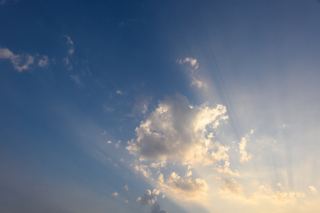 ray of sun light on clouds and blue sky