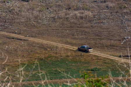 car moving in dry fields