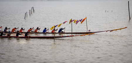 Unidentified people boats racing on Buddhist Lent Day or Rains-Retreat for the buddhist monks to dwell permanently at a suitable place