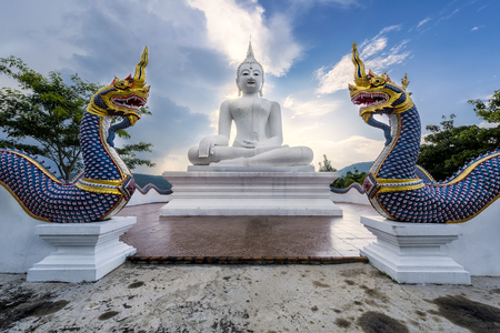 white buddha statue and blue sky