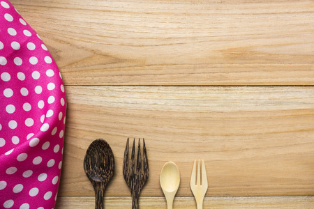 hankie and spoon on wood background top view