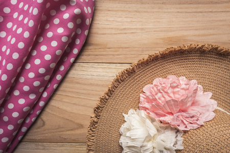 hankie and hat on wood background top view, summer tone