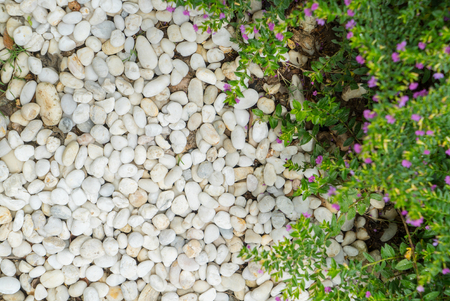 White stone.The stone is used to decorate the garden.The stone background is beautiful.