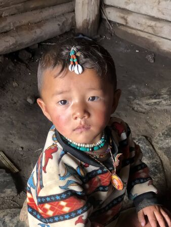 July 21,2018 Gansu,China Tibetan children are looking at cameras in the provinces countryside 에디토리얼
