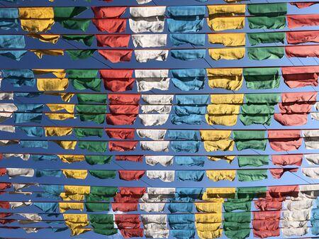 tibetan prayer flags wind flying  on the blue sky