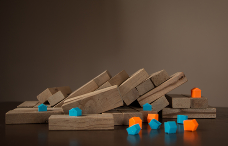 Collapsed wood blocks stack game, background concept and model house fall disorderly