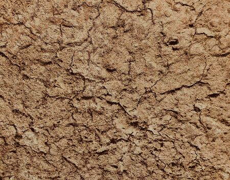 Brown dry soil background At the top view,Soil cracks desert sands water evaporation stagnation and global warming large cracks in clay soil due to water evaporation Stock Photo