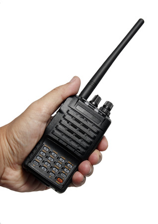 transceiver: Hand holding Black Radio transceiver on White background