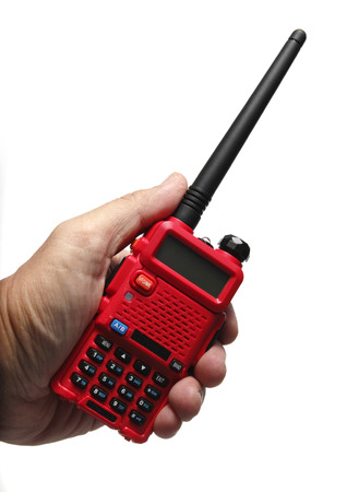transceiver: Hand holding Red Radio transceiver on White background