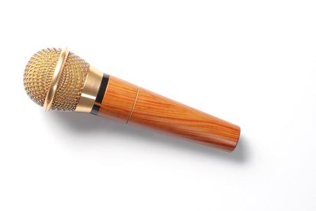 voices: Gold microphone in White background