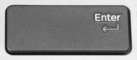 enter button: Black Enter Button Closeup shot Stock Photo