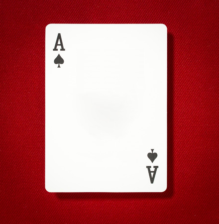 Black Ace Card on Red Background