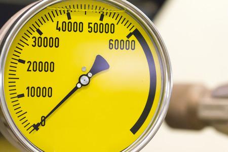 metering: Industrial Yellow Pressure Guage Closeup