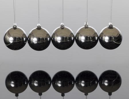 kinetic energy: Momentum ball in Dark Reflect Stock Photo