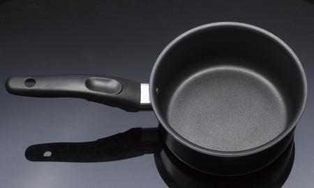 teflon: Black Handle Teflon Pot in Black background Stock Photo
