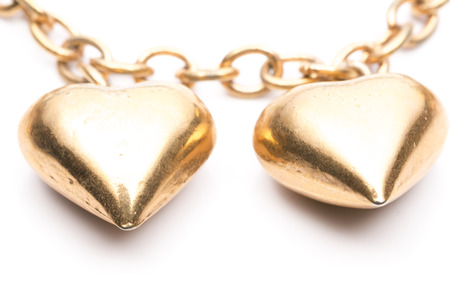 locket: Two Gold Hearts Locket in White background