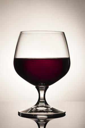 şarap kadehi: Red Wine Glass Glossy Floor Stok Fotoğraf