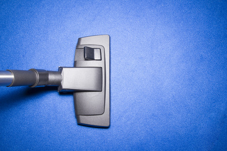 cleaner: Head of Vacuum cleaner on Blue carpet from top view Stock Photo