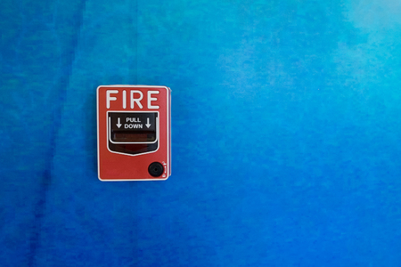 blue wall: Red Fire Alarm on Blue Wall