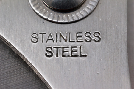 steel background: Stainless steel text on Tool macro shot