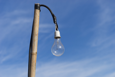 electric bulb: Old light bulb on Bamboo with Blue Sky