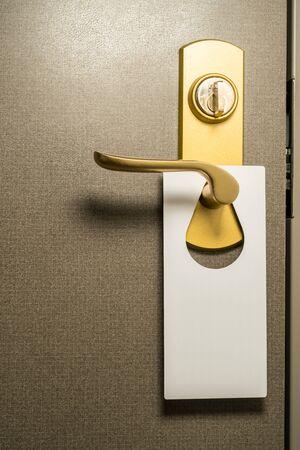 No disturb tag hanging on Door lever handle