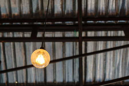 Old retro light bulb hanging from the roof light bulb hanging from the roof