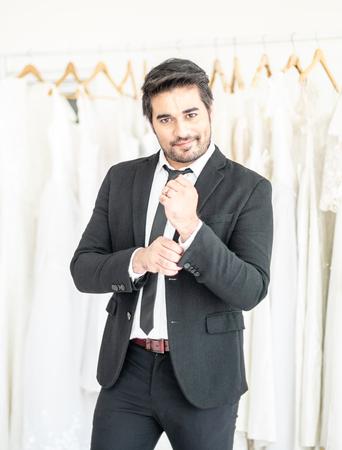 Smart Groom in Black suit smiling Banco de Imagens