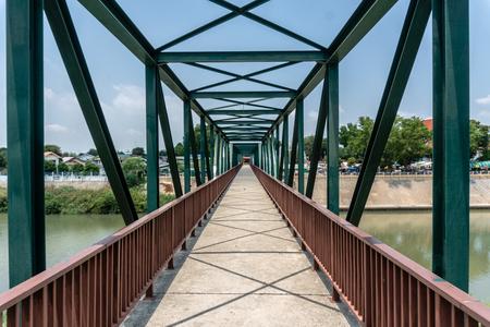 Small Steel Bridge for Walking across Pasak River ,Tha Luang, Tha Ruea District, Phra Nakhon Si Ayutthaya, Thailand Banco de Imagens