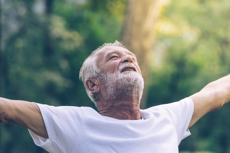 Elderly man happy with freedom life in Vintage tone