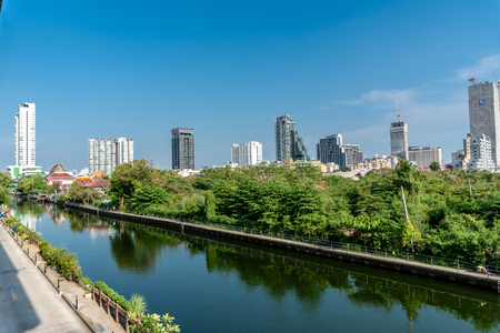 Bang Sue Canal in Bangkok, Thailand with Office Building in Background in Summer