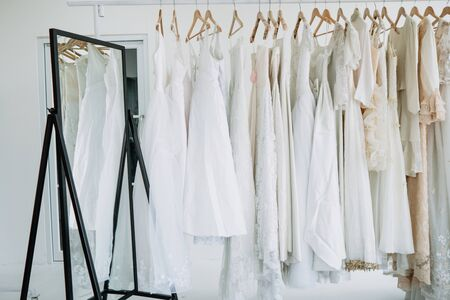 Hanger for bride in Bridal gown dressing room and a large mirror is located inside the room