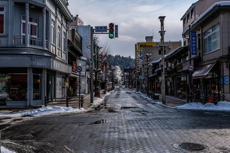 Gifu, Japan - Feb 8, 2018 : In winter, Atmosphere in Takayama city. the crossroads in the city are snowy and wet slippery roads