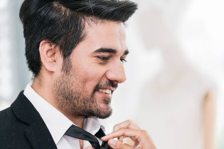 Groom dressing Prepare to attend the wedding ceremony with smiling closeup Banque d'images