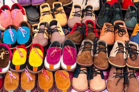 Children shoes on a sidewalk shop  photo