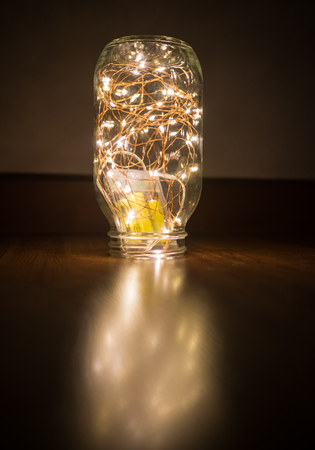 Wired led lamp in glass bottle on the floor Stock Photo