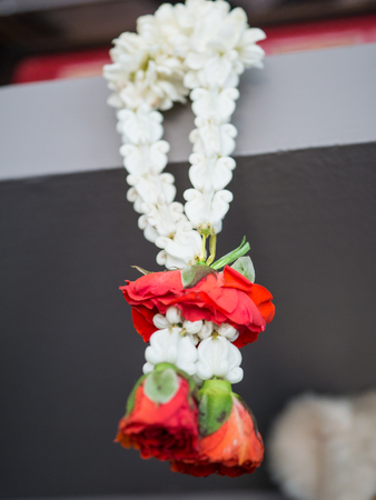 Red rose in Thai style garland
